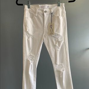 white skinny distressed jeans